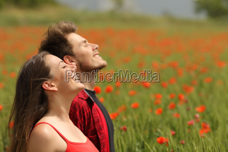 happy couple breathing fresh air in