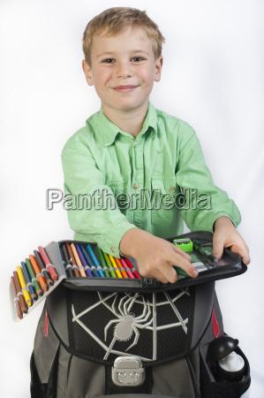 6 year old boy with schoolbag