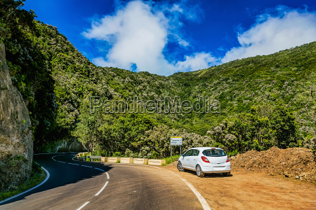 asphalt road and car in mountains