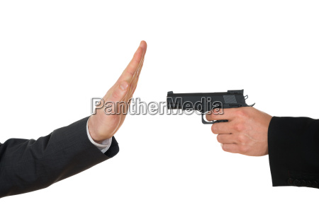 businessman aiming with gun to another