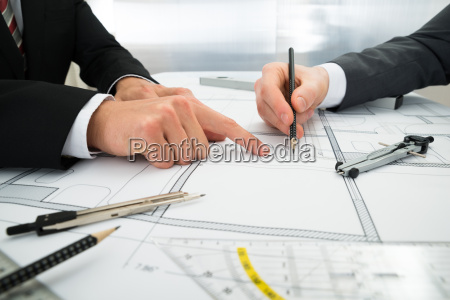 close up of two architects working