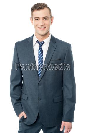 young businessman posing stylishly