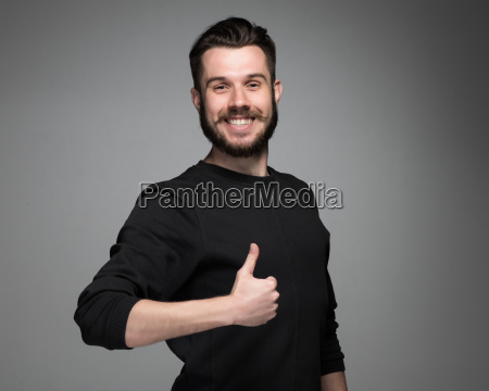 portrait of handsome young smiling man