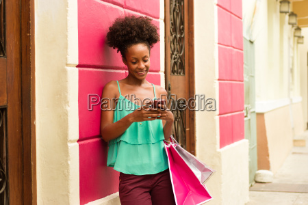 black girl shopping and text messaging