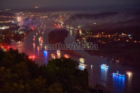 illuminated city at night with ships