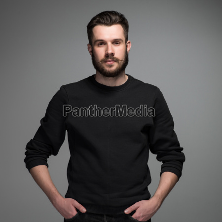 fashion portrait of young man in