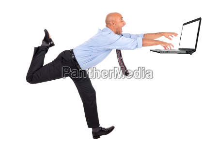 businessman chasing laptop
