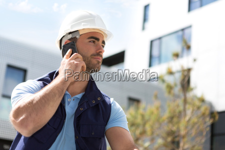 yong attractive worker using mobile phone