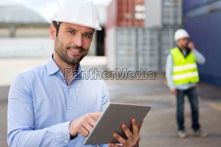 young attractive engineer using tablet on