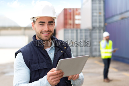 young attractive docker using tablet at
