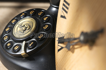 ancient clock and phone