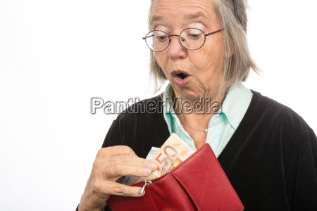 old woman brings money out of
