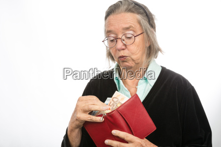 old woman taking money from wallet