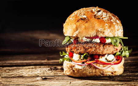 burger piled high with toppings on