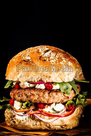 close up of burger piled high