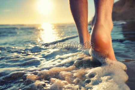 enjoying a walk barefooted at the
