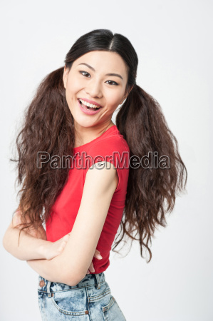 smiling woman with folded arms