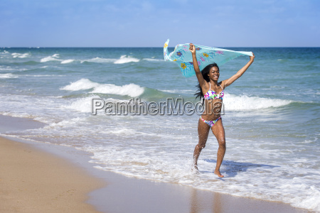 young woman at the beach with