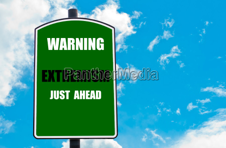 warning extremism just ahead written on