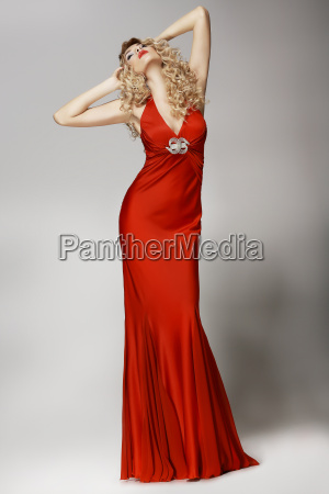 seductive shapely woman in red dress
