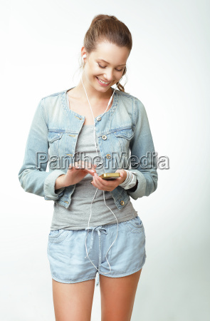 young woman in jeans with smartphone