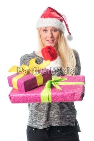 christmas woman with gifts pointing his