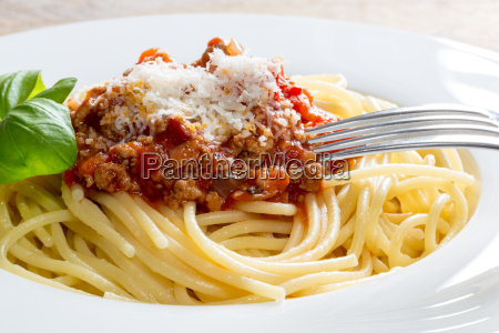 spaghetti with bolognese sauce parmesan cheese