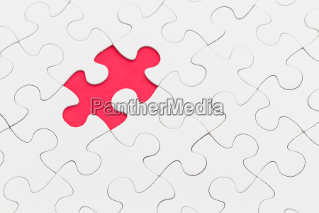 puzzle with missing piece over red