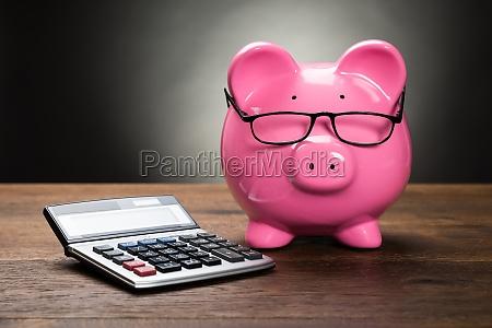 piggybank with calculator