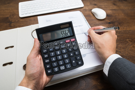businessperson calculating financial result