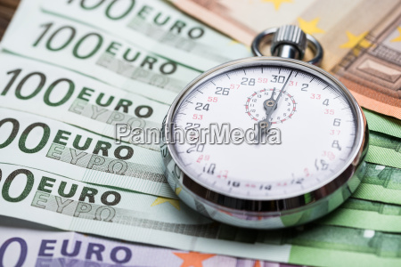 stopwatch on banknotes