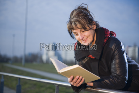 reading at the railing