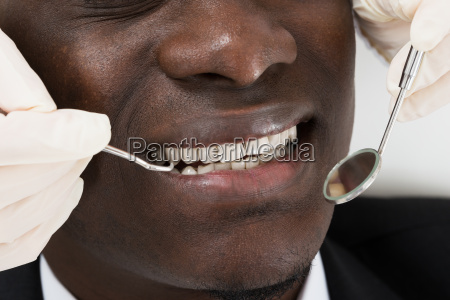 doctor doing dental check up of