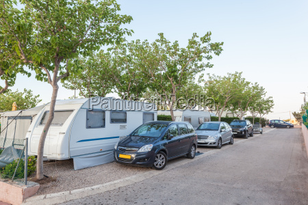 camping street with caravans and cars