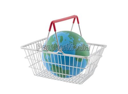 shopping basket with globe isolated on
