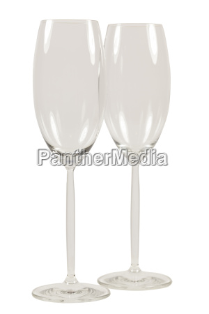 two empty champagne glasses with long