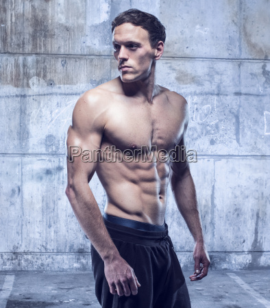 fitness male model in old garage