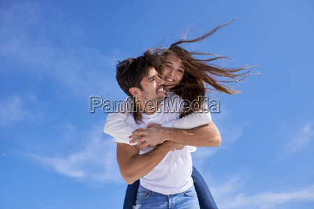 happy young romantic couple have fun