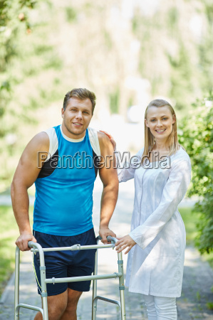clinician with disabled man