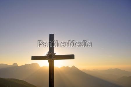 summit cross in the evening panorama