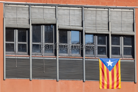 flag of catalonia on the window