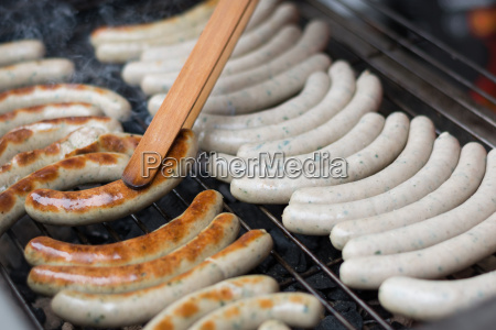 delicious sausages on grill