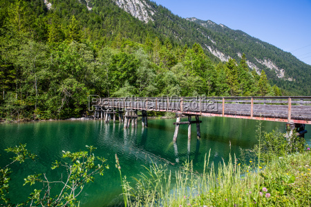 wooden bridge at plansee in austria
