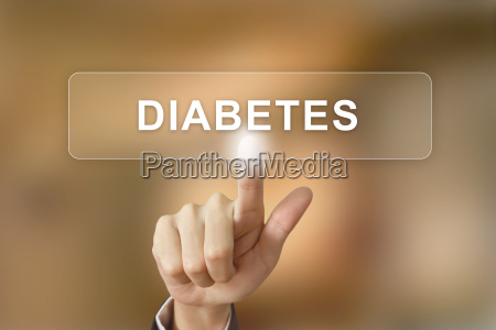 hand clicking diabetes button on blurred