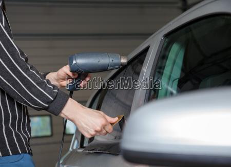 applying tinting foil on a car
