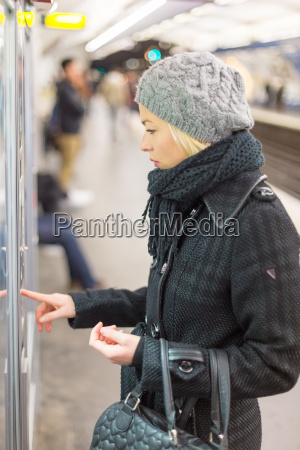 lady buying ticket for public transport
