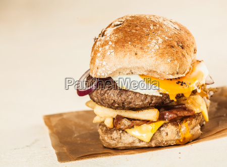 homemade burger with patty cheese and