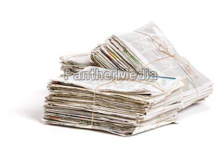 several newspaper bundles