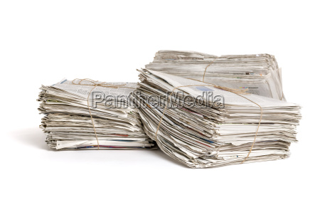 three bundles of newspapers against a