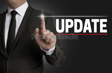 update touchscreen is operated by businessman